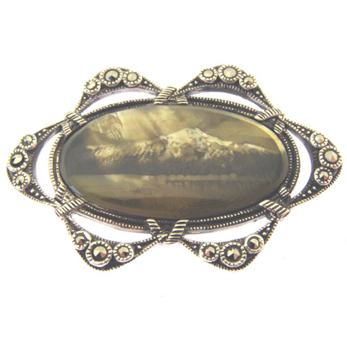 candle smoked silver brooch