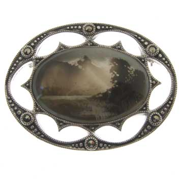 hallmarked candle smoked brooch with mountain lake scene