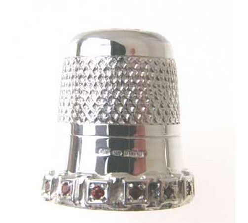 sterling silver thimble set with rubies