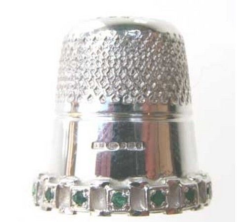 hallmarked silver thimble set with emeralds