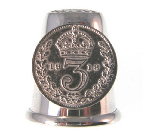 sterling silver thimble with a silver thruppence