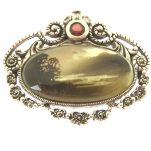 candle smoked silver brooch with garnet