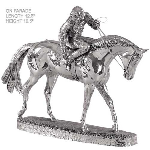 silver figure of a race horse on parade