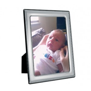 silver picture frame with bead pattern border. 6 inch x 4 inch sight area