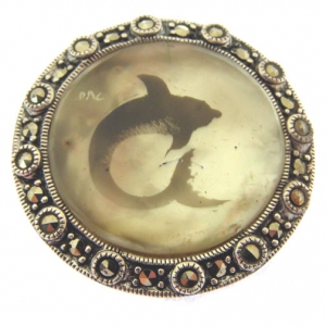candle smoked silver dolphin brooch on mother of pearl