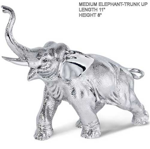 medium hallmarked silver elephant with trunk pointing upwards